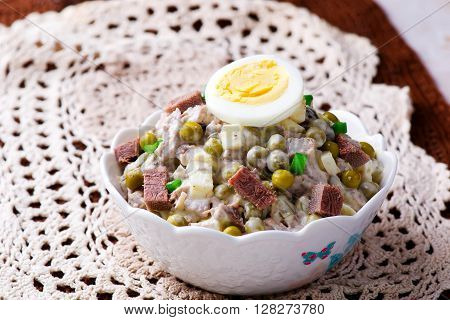 salad with veal tonque and mayonnaise. selective focus