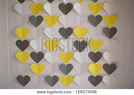 Coloured yellow and black heart shaped papercuts