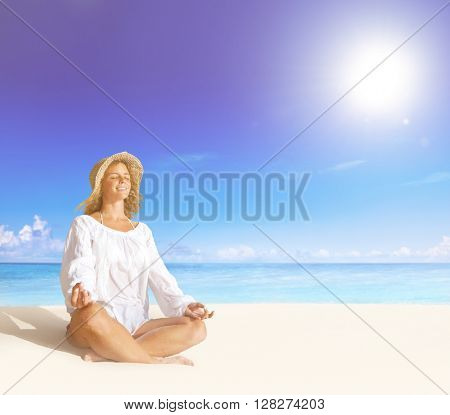 Beautiful Lady Doing Yoga On The Beach Concept