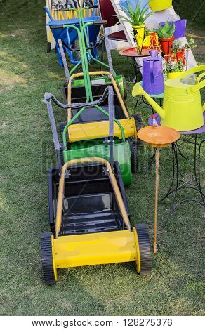 Lawn Mowers And Watering Cans