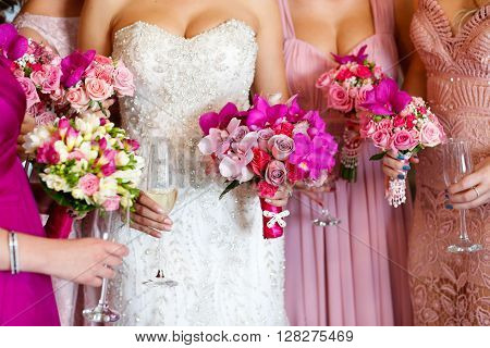 Bride With Bridesmaids Holding Beautiful Flower Bouquet