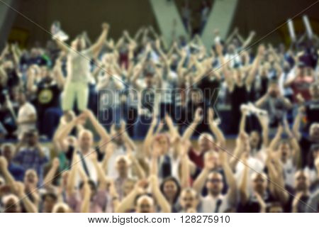 Blurred background of crowd of people in a basketball court