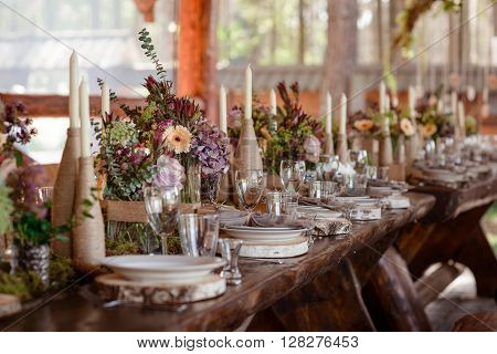 beautifully decorated wedding table in rustic style