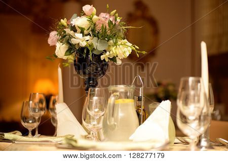 Nice wedding table decoration with flowers and limone juice