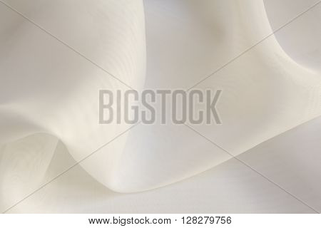 Shiny White silky fabric folds background texture