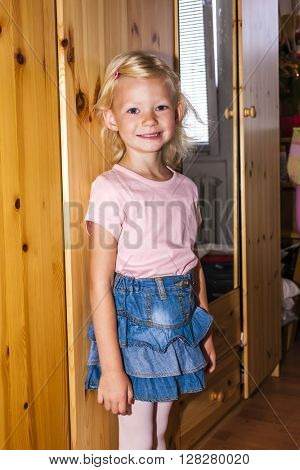 standing little girl wearing a skirt