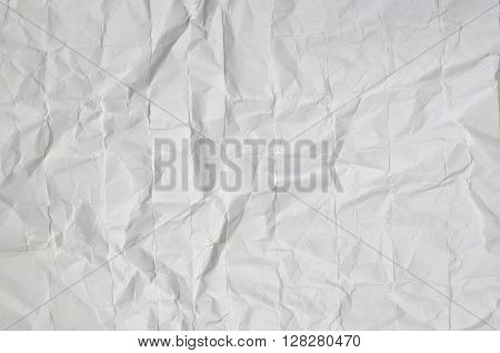 Close up of a creased, white, paper texture, full frame, horizontal