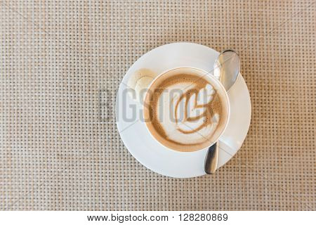 White Cup Of Latte Coffee On Wooden Tray