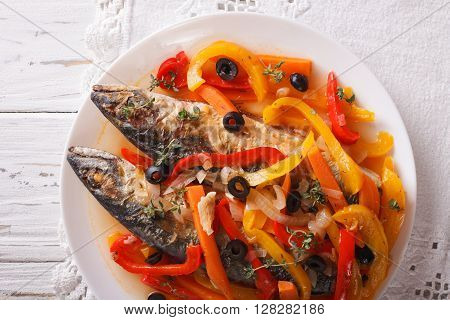 Mackerel In Vegetable Marinade Close-up On The Table. Horizontal Top View