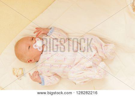 lying newborn baby girl