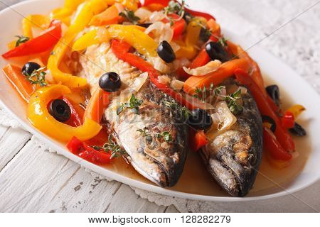 Mackerel In Vegetable Marinade Close-up On The Table. Horizontal
