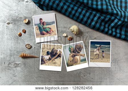 Beautiful seaside snapshots arranged on rustic wooden background with seashells and a scarf around horizontal top view