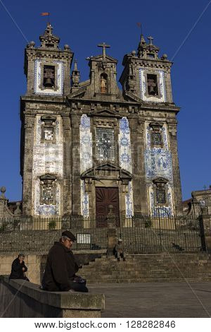 PORTO, NORTE, PORTUGAL - DECEMBER 6, 2015: People in front of Church of Saint Ildefonso in Porto.