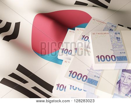 Korean won banknote bundles on textile textured South Korea flag.