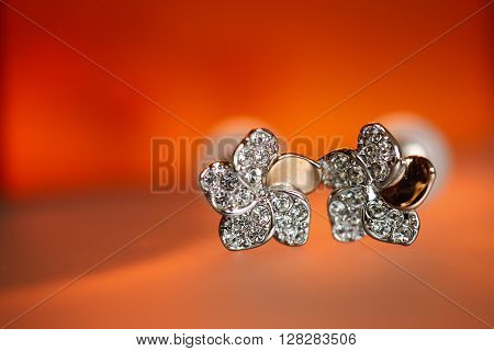 Closeup with elegant bride brooch on a red background