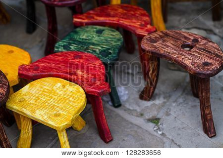 Old fashion colored chairs at rural market in travel destination