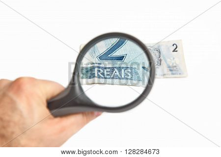 Magnifying Glass on the two Brazilian Reals.
