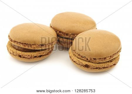 colorful freshly baked macarons on a white background