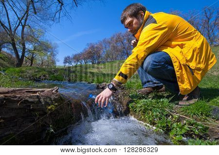 Man Taking Water From Forest On Hiking Trip01