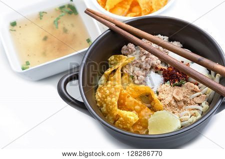 Spicy lemongrass flavored flat noodles with pork Asian foods