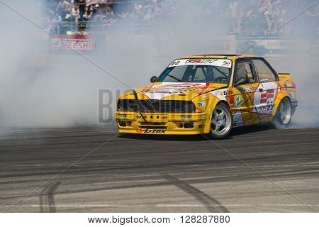 Lviv Ukraine - Juny 7 2015: Unknown rider on the car brand BMW overcomes the track in the championship of Ukraine drifting in Lviv.