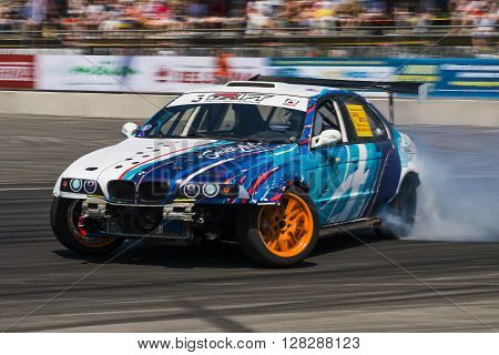 Lviv Ukraine - Juny 6 2015: Rider Igor Zapisniy on the car brand BMW overcomes the track in the championship of Ukraine drifting in Lviv.