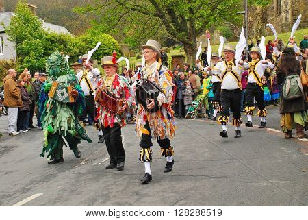 HASTINGS, ENGLAND - MAY 2, 2016: Morris dancers perform during the parade through the Old Town at the annual Jack In The Green festival. The event marks the May Day public holiday in Britain.