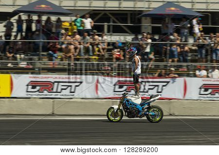 Lviv Ukraine - June 7 2015: Unknown stunt biker entertain the audience before the start of the championship of Ukraine drifting in Lviv.