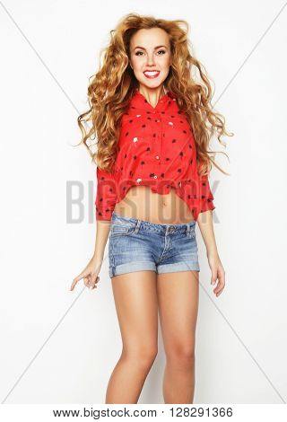 happiness, freedom, movement and people concept - smiling young woman jumping in air