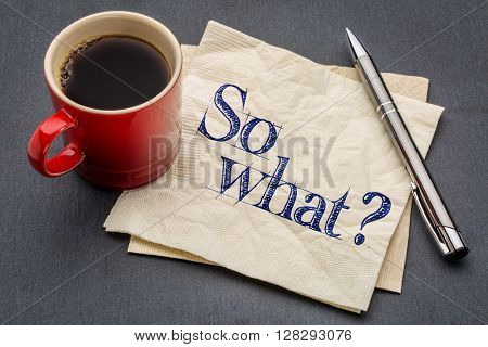 So what question - handwriting on a napkin with a cup of espresso coffee
