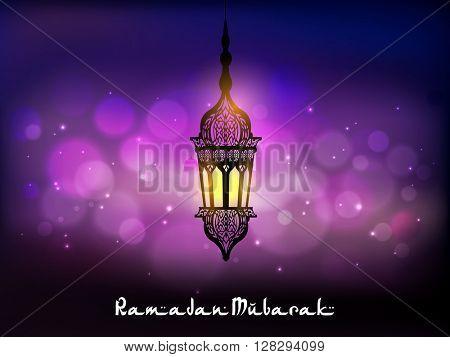Beautiful traditional hanging Lamp on shiny background for Islamic Holy Month, Ramadan Mubarak celebration.