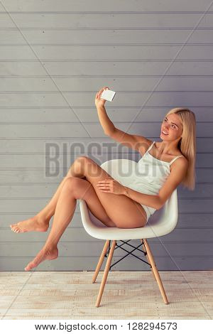 Attractive Blonde Girl With Gadget