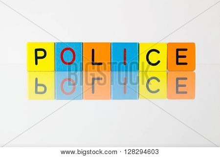 Police - an inscription from children's wooden blocks