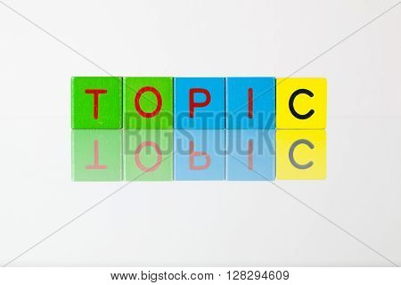 Topic - an inscription from children's wooden blocks