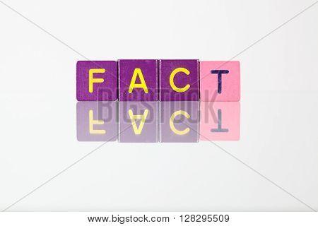 Fact - an inscription from children's wooden blocks