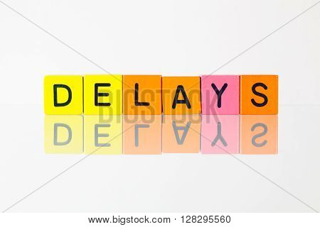 Delays - an inscription from children's wooden blocks