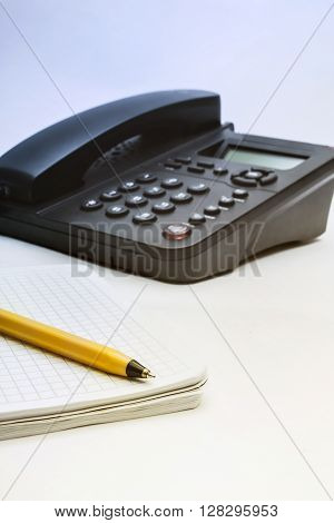 Black Ip Phone, Notebook And Pen