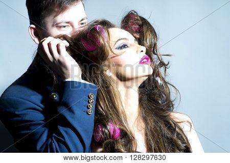 Man And Girl With Hair Curlers