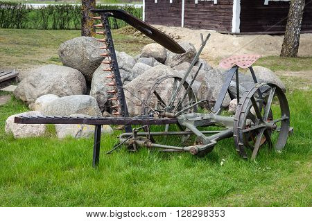 Agriculture old antique plough on grass, equipment for farming