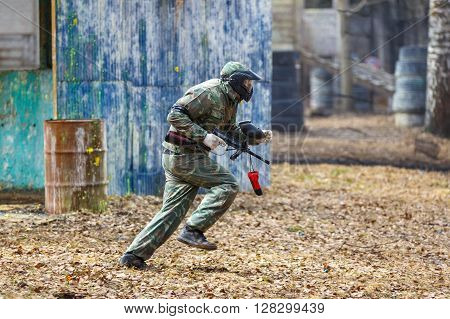 Saint-Petersburg, Russia - April 10, 2016: Paintball student tournament of Bonch Bruevich university in Snaker club. Shooter running.