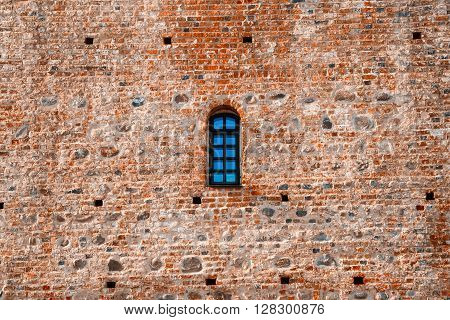 Arched Window In A Aged Red Brick Castle Wall
