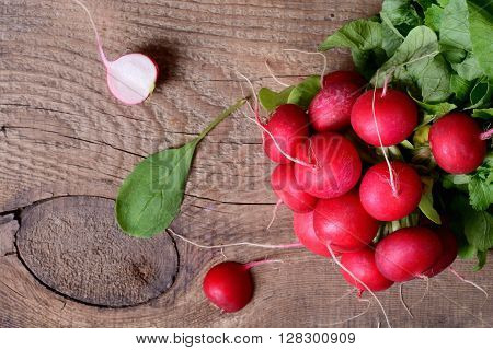 large bunch of fresh radish on wooden boards closeup