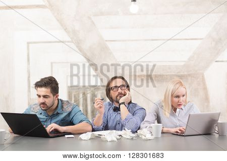Busy business people sitting at table in office and working upon business projects in company. Businessteam concept.