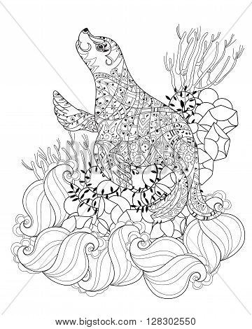 Hand drawn doodle outline sea lion decorated with ornaments.Vector illustration.Floral ornament.Sketch for tattoo or coloring pages.Boho style.