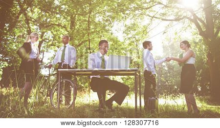 Environmental friendly themed picture of business people working.