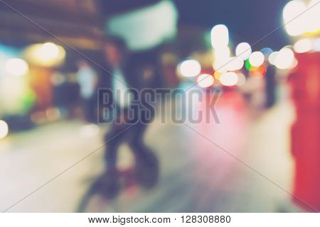 Abstract Blurred Street Scene With Bike Rider