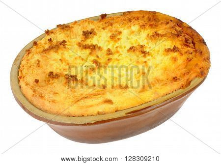 Home made traditional mashed potato topped cottage pie in a rustic earthenware pie dish isolated on a white background