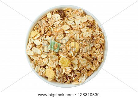 Muesli breakfast in white bowl isolated on white background. Top view.