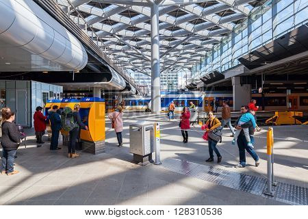 The Hague Netherlands - April 21 2016: main station with unidentified people. It is the with twelve tracks the largest terminal station in the Netherlands. The station was completed in 1973
