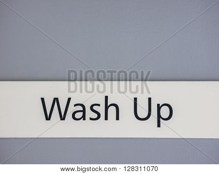 Sign on a door leading to the area where washing up of dishes takes place in a restaurant kitchen